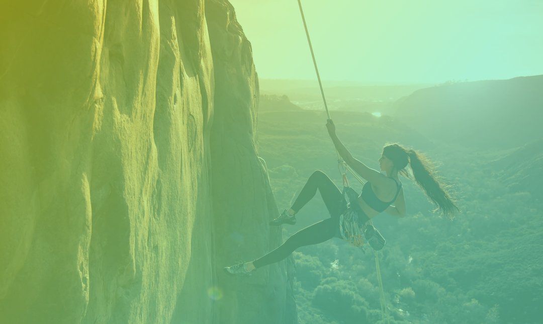 Passion and persistence - Girl climbing on a mountain